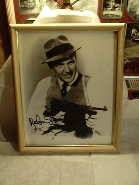 Signed photo of Robert Stack wearing the hat