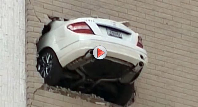 tulsa man drives mercedes through parking wall backwards with video. Black Bedroom Furniture Sets. Home Design Ideas
