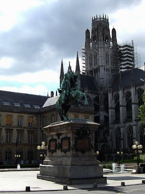 statue and St. Ouen Church