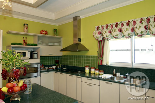 The Kitchen Wallsu0027 Bright Apple Green Color Is Complemented By The  Red And White Floral Curtains. Though The Kitchenu0027s Colors May Be A Bit  Country Ish, ...