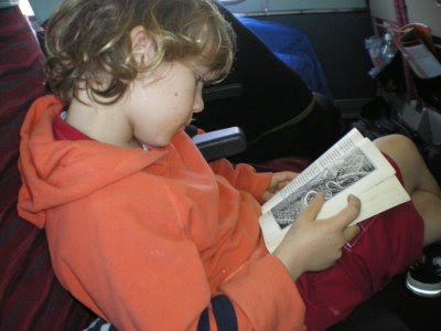 Peregrine reading on the Ghan