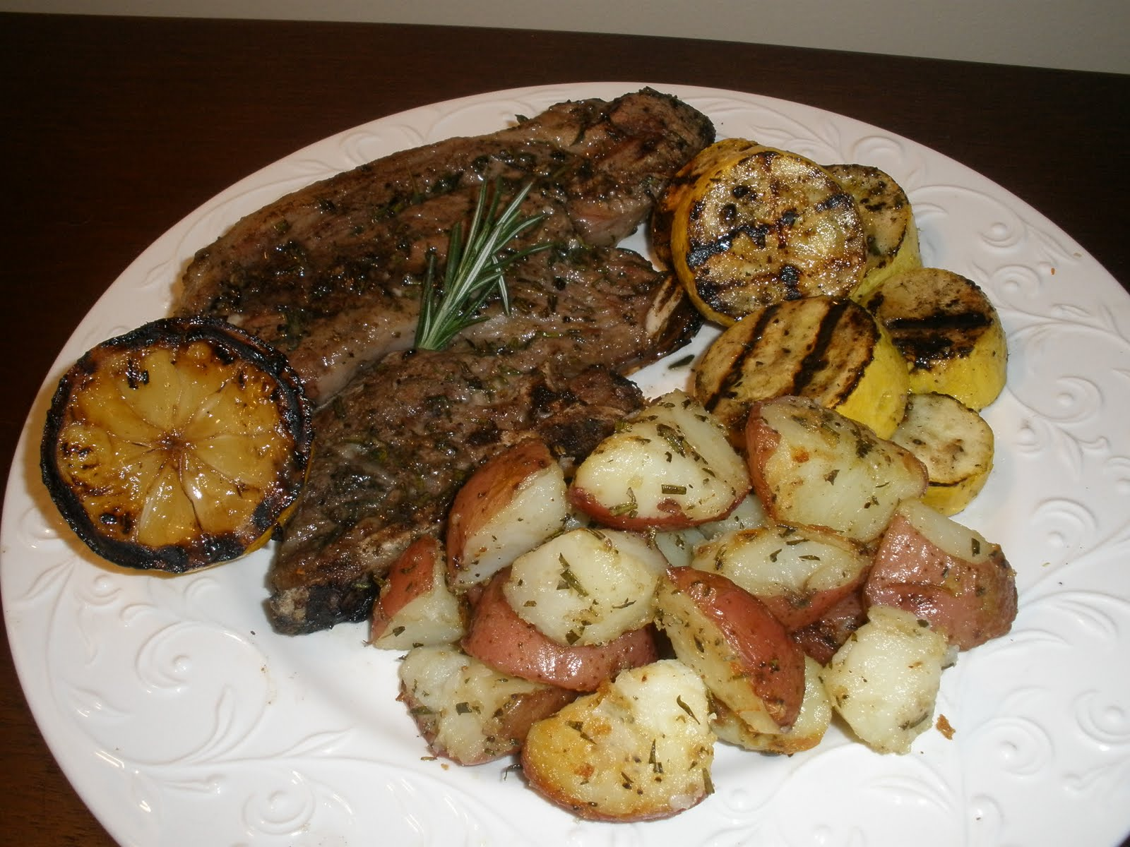 Grilled Lamb Chops with Fresh Herbs and Grilled Lemon