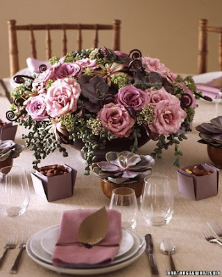 Centerpiece 1 in purples and browns with roses succulents and fern curls