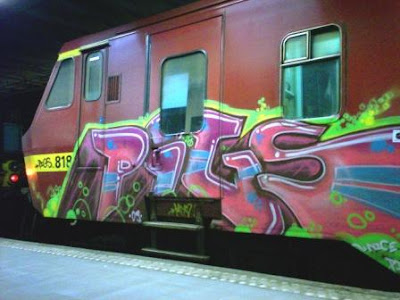 train graffiti with pigs