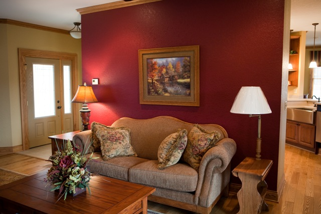 use color to make the space more intimate dark warm colors on the