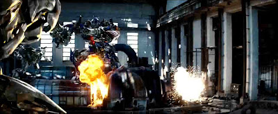 Prime's two guns aimed at Megatron