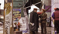 News vendor and Rorschach in a scene from Watchmen