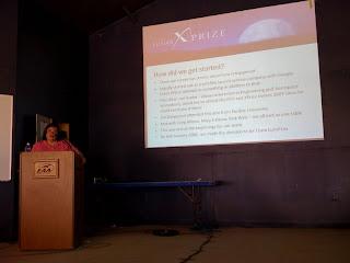 Maragaret presents Google Lunar X PRIZE Team LunaTrex at EAA AirVenture 2008. Photo Credit: D. Trujillo, X PRIZE Foundation
