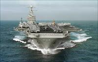 Déploiement du porte-avion USS Dwing Eisenhower (CVN-69), classe Nimitz, dans le golfe Persique en janvier 2007. Il sera suivi par tout un armada.