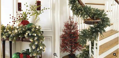 Lit outdoor holiday wreaths, garland and other foliage with