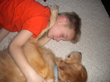 Landen and my sisters dog Roma awe