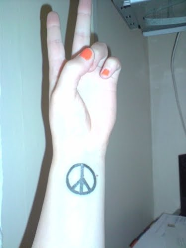 small tattoo of peace tattoo lady gaga on wrist :