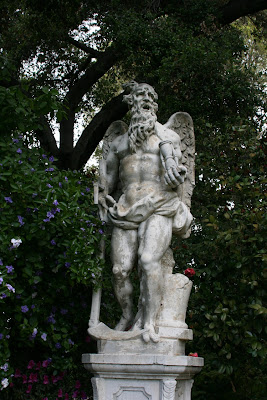 Winged Father Time statue