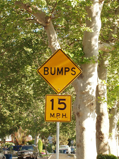 15mph Bumps street sign