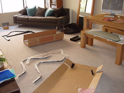 Having fun assembling two TV stands - thank god I had enough space to spread myself out!