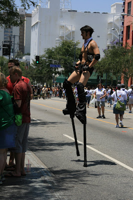 Stilt-man posing for the crowds