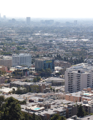Watchmen movie billboard dominating the Los Angeles skyline