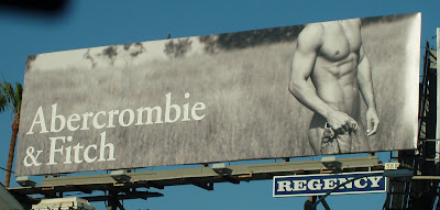 Abercrombie & Fitch male model in field billboard