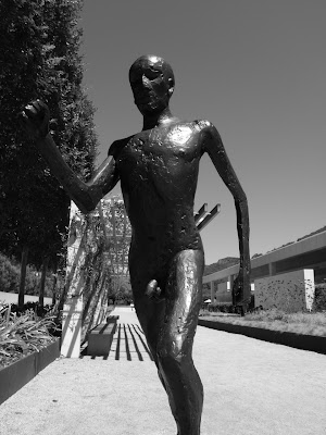 Elisabeth Frink's Running Man sculpture in mono