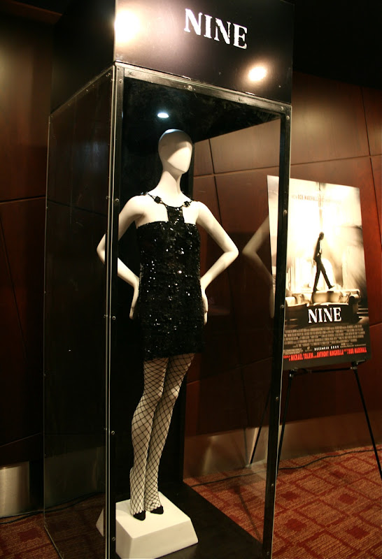 Nine Kate Hudson black dress film costume