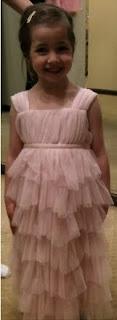 four-year-old Rachel Rosenberg in her pink flower girl dress