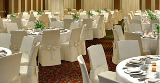 Eventi hotel ballroom with tables set