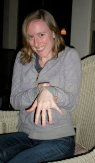 the bride shows off her engagement ring
