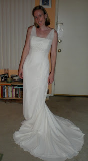 the bride in the white wedding gown she picked