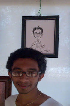 prashanth-abstract artist-along with his caricature framed