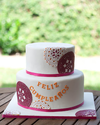 pink and white papel picado cake