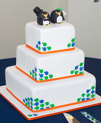 Orange, green, and blue wedding cake