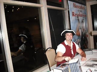 Signing copies of Hercules of the Revolution