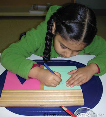 NAMC montessori normalization classroom girl writing