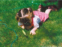 NAMC montessori twos activity presentation observing nature close up girl on the grass