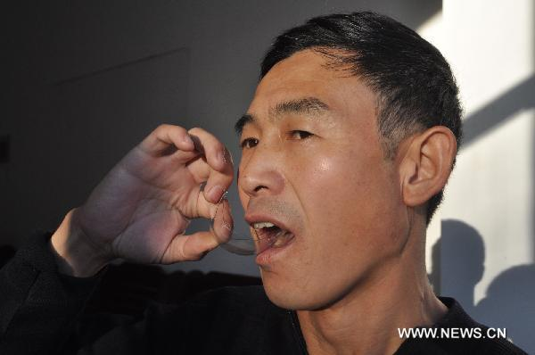China's Man Eating 3 Light Bulbs in 120 seconds from Mudanjiang  City Seen On www.coolpicturegallery.us