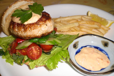 Chicken burger with chips and creamy chilli sauce