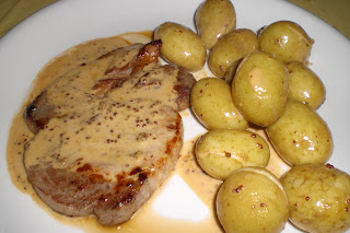 Mustard pork chops with baby potatoes