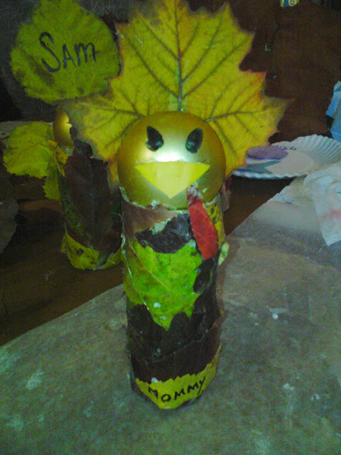 Recycled Turkey toilet paper roll, old ornament, and fall leaves.