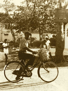 Joseph Spence on Bicycle