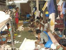 schiavi produttori di scarpe