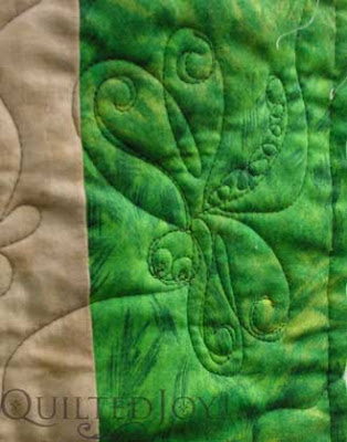 """Close up of free-handed dragonfly, featured on a novelty """"bug and frog"""" quilt for a lucky grandson."""