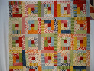 Log Cabin quilt, quilted by Angela Huffman