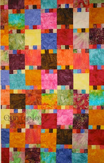 Colorful batik quilt, waiting in the wings