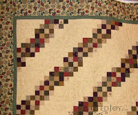 Jelly Roll quilt with Moda fabrics, quilted by Angela Huffman