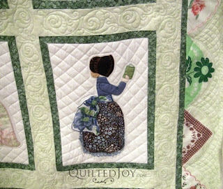 September block in a Hankie Lady Obsession Quilt with custom quilting by Angela Huffman - QuiltedJoy.com