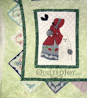 October block in a Hankie Lady Obsession Quilt with custom quilting by Angela Huffman - QuiltedJoy.com
