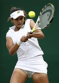 India's Sania Mirza plays a return during her singles match against Russia's ...