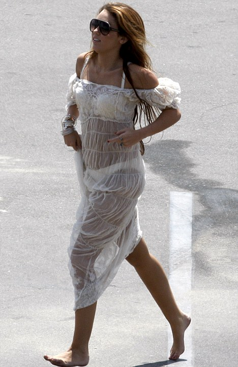 ... barefoot around a car park in a see-through dress yesterday. Enjoy