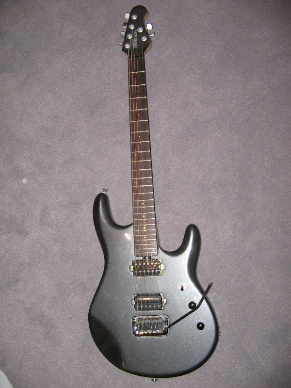 Sim, é uma OLP John Petrucci modificada.