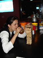 GFL demonstrates her Jenga skills. Sort of.